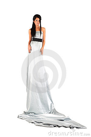 Girl wearing long silver dress looks mysteriously