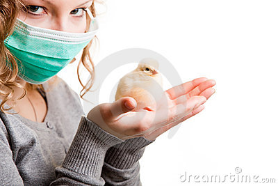 Girl wearing mask with chicken