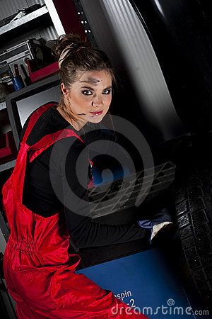 Girl wearing mechanic uniform