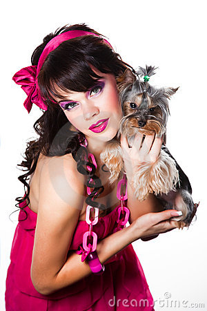 Girl wearing pink with small yorkshire terrier