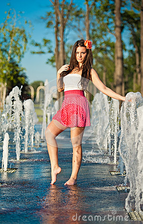 Free Girl Wearing Red Skirt Playing Water Fountain Royalty Free Stock Photo - 25704655