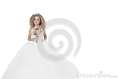 Girl in wedding dress holding flower bouquet while looking away over white background