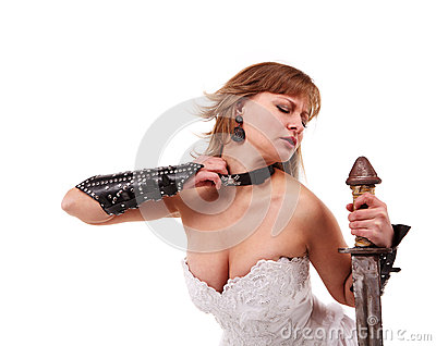 Girl in a wedding dress with a sword
