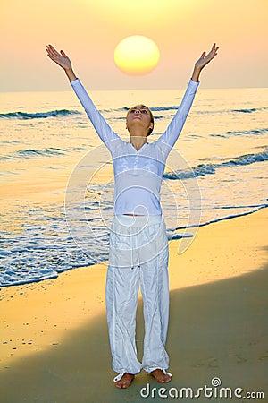 Girl welcoming rising sun