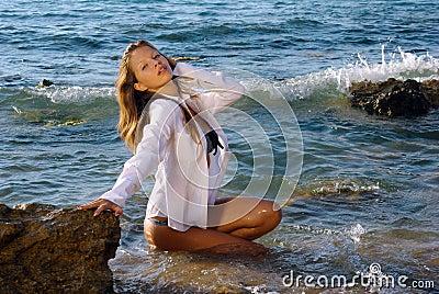 Girl in a wet white shirt