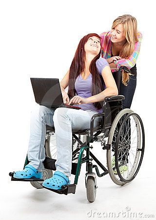 Girl on the wheelchair with friend and aptop