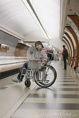 Girl in wheelchair in subway