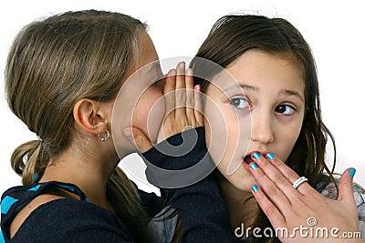 Girl whispering a secret