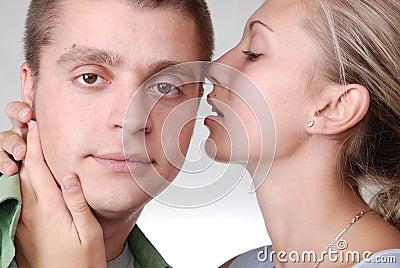A girl whispering something tenderly to her boyfri