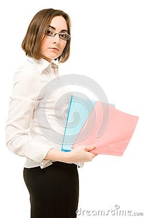 Girl in white demonstrating two folders