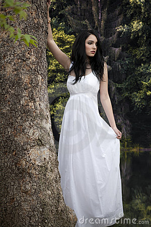 Girl in white dress in forest