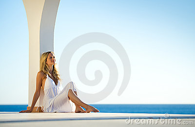 Girl in white dress at Sunset by the sea 4