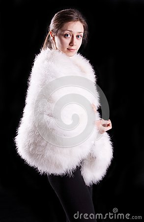 The girl in a white fur coat