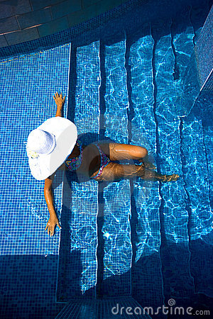 Girl, white hat and swimming pool