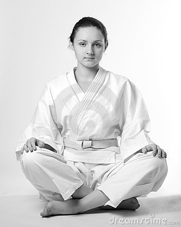 Girl in white kimono sitting traditionally