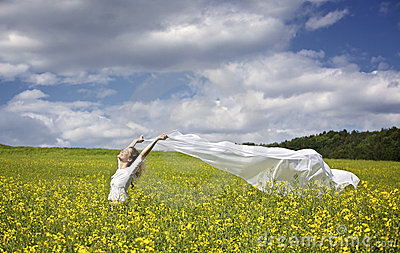 Girl with white piece of cloth in wind