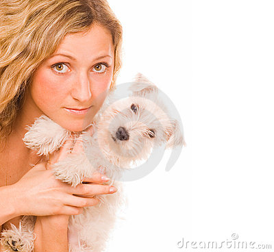 Girl with a white puppy