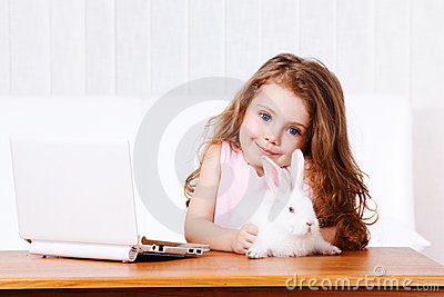 Girl with white rabbit and laptop