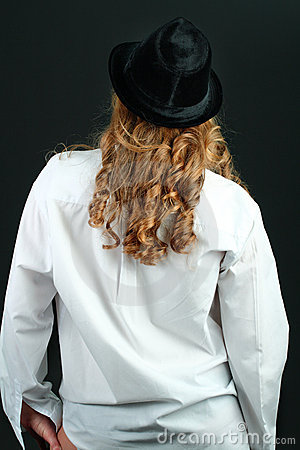 Girl in white shirt and black hat with long hair