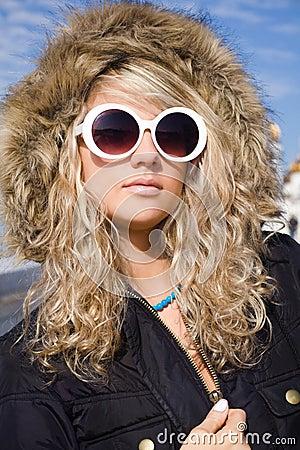 Girl in white sun glasses