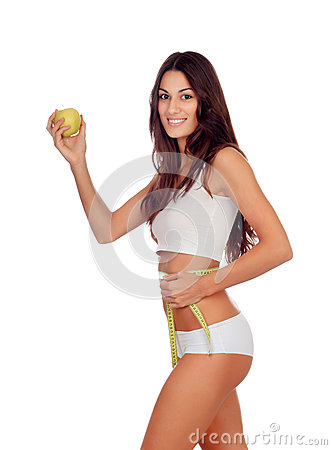 Girl in white underwear with a apple and tape measure