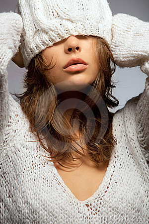 Girl in white wool and cap