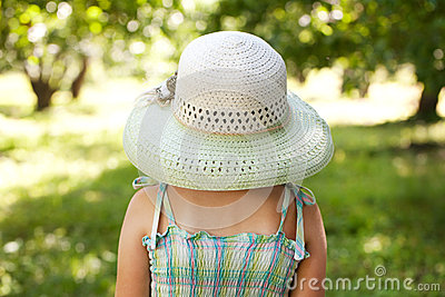 Girl in a wide-brimmed hat