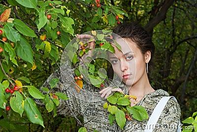 Girl and wild apple tree