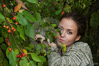 Girl and wild apple tree