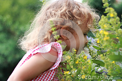 Girl and wildflowers. Enjoyment.