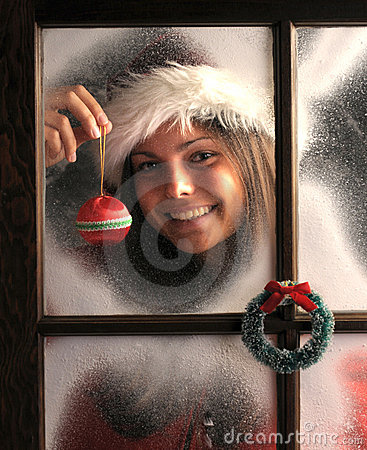 Girl in Window with Christmas Ornament