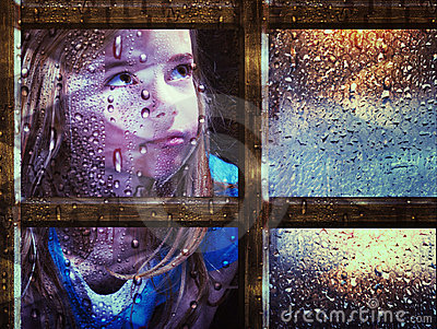 Girl at window in rain
