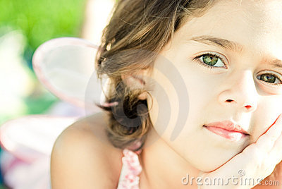 Girl with wings at the park