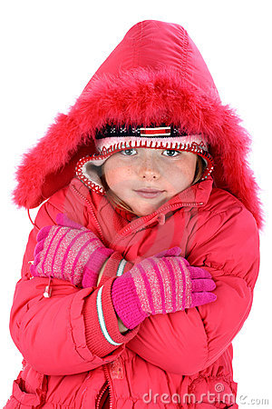 Girl in winter clothes embracing herself isolated