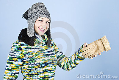 Girl in winter clothes having fun