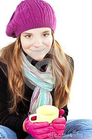 Girl in winter clothes holding cup of warm cure