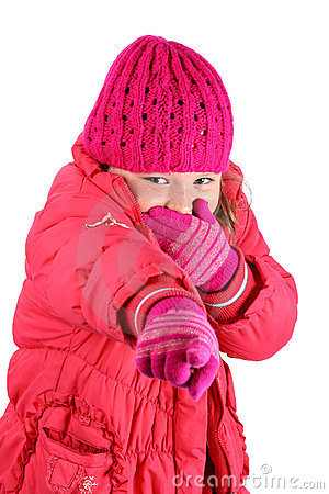 Girl in winter clothes laughing pointing a finger