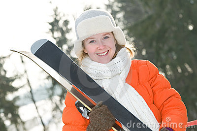 Girl at winter clothing with skis