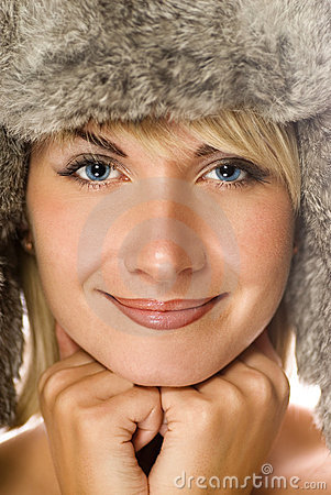 Girl in winter fur-cap