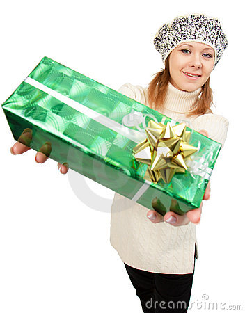 Girl in winter hat gives gift box