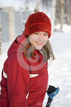 The girl in a winter red cap smiles