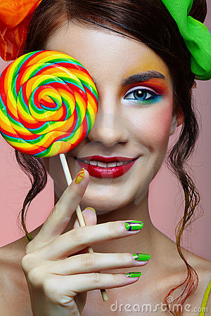 Free Girl Wit Lollipop Royalty Free Stock Image - 12475446