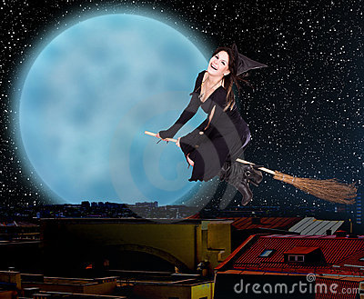 Girl witch fly over city against moon and star sky