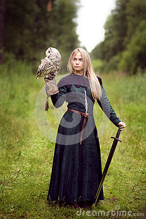 Free Girl With A Sword Holding An Owl Stock Photos - 76073383