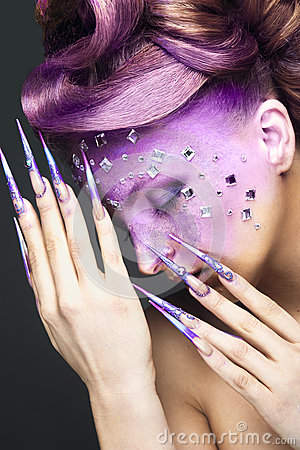 Free Girl With Bright Purple Creative Makeup With Crystals And Long Nails. Beauty Face. Stock Images - 52048474