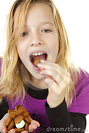 Free Girl With Ginger Nuts (pepernoten) Royalty Free Stock Images - 16646529