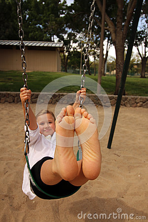 Free Girl  With Her Feet Together In The Air Swinging Royalty Free Stock Images - 57547219