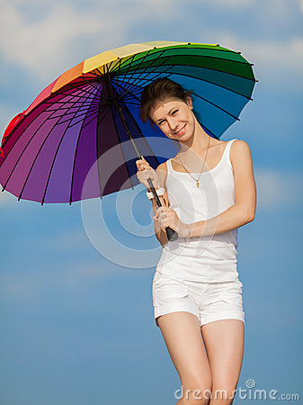 Free Girl With Iridescent Umbrella Looking At Camera On Background Of Stock Photo - 36924630