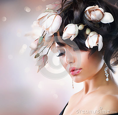 Free Girl With Magnolia Flowers Royalty Free Stock Photography - 25882407
