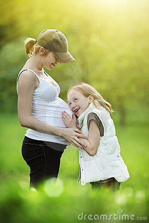 Free Girl With Pregnant Mother Stock Photography - 17326512